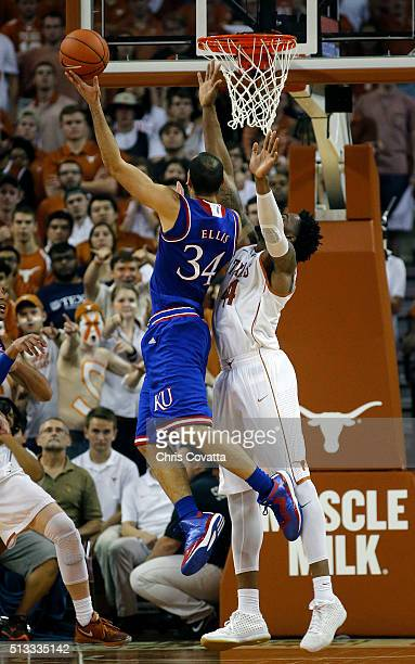 Perry Ellis of the Kansas Jayhawks shoots over Prince Ibeh of the Texas Longhorns at the Frank Erwin Center on February 29 2016 in Austin Texas
