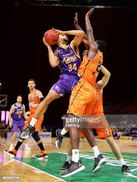 Perry Ellis of the Kings injures his shoulder while driving to the basket during the round eight NBL match between the Sydney Kings and the Cairns...