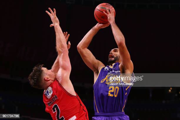 Perry Ellis of the Kings shoots past Lucas Walker of the Wildcats during the round 13 NBL match between the Sydney Kings and the Perth Wildcats at...
