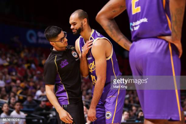 Perry Ellis of the Kings shows discomfort after injuring his shoulder during the round eight NBL match between the Sydney Kings and the Cairns...