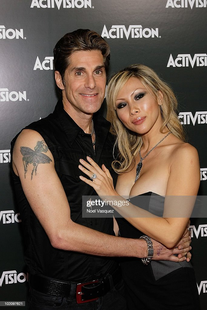 Perry Farrell (L) and Etty Farrell attend the Activision E3 2010 kick-off event at the Staples Center on June 14, 2010 in Los Angeles, California.