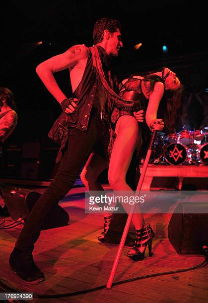 Perry Farrell and Etty Farrell of Jane's Addiction perform during the 2013 Rockstar Energy UPROAR Festival at Nikon at Jones Beach Theater on August...
