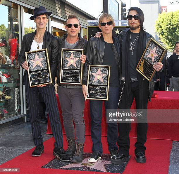 Perry Farrell Stephen Perkins Chris Chaney and Dave Navarro attend the ceremony honoring them with a Star on The Hollywood Walk of Fame on October 30...