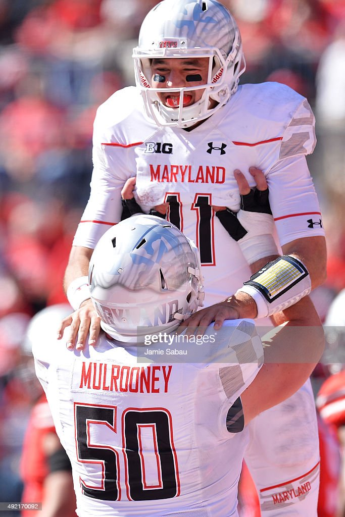 Perry Hills #11 of the Maryland Terrapins celebrates with Evan Mulrooney #50 of the Maryland Terrapins after his four-yard touchdown run in the third quarter against the Ohio State Buckeyes at Ohio Stadium on October 10, 2015 in Columbus, Ohio. Ohio State defeated Maryland 49-28.