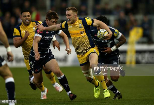 Perry Humphreys of Worcester Warriors hands off Alan MacGinty of Sale Sharks during the Aviva Premiership match between Sale Sharks and Worcester...