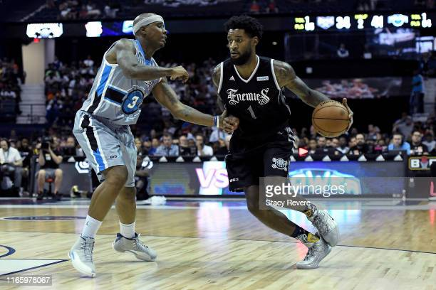Perry Jones III of the Enemies dribbles the ball while being guarded by Quentin Richardson of the Power in the second half during week seven of the...