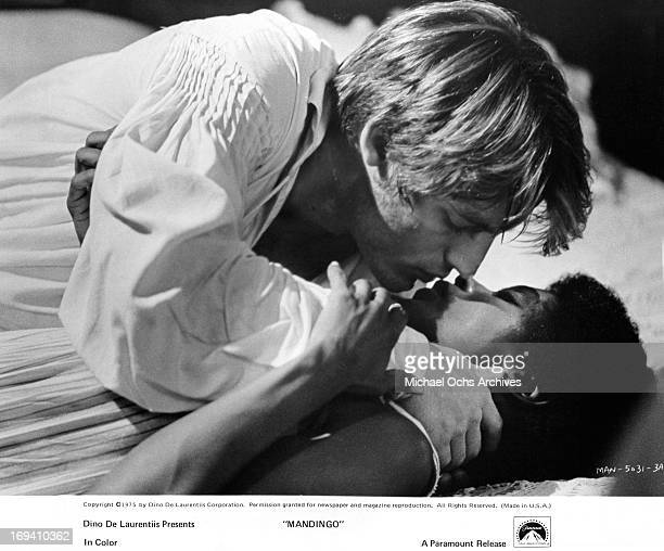 Perry King making love to slave Brenda Sykes in a scene from the film 'Mandingo' 1975