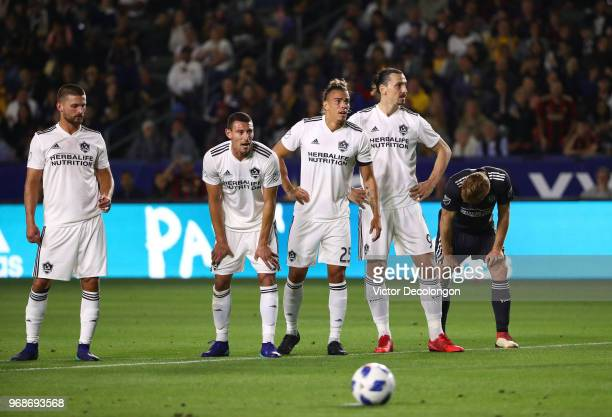 Perry Kitchen Daniel Steres Rolf Feltscher and Zlatan Ibrahimovic of the Los Angeles Galaxy and Jeff Larentowicz of Atlanta United line up prior to a...