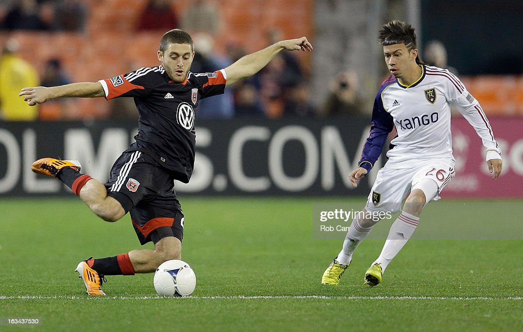 Perry Kitchen #23 of D.C. United passes the ball in front of Sebastian Velasquez #26 of Real Salt Lake during the first half at RFK Stadium on March 9, 2013 in Washington, DC.
