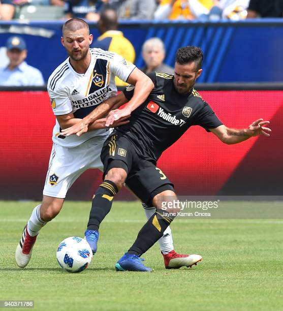 Perry Kitchen of Los Angeles Galaxy and Steven Beitashour of Los Angeles FC battle for the ball in the second half of the game as at StubHub Center...