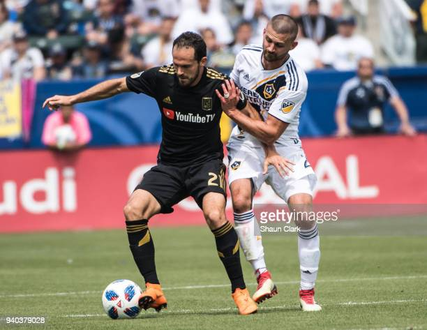 Perry Kitchen of Los Angeles Galaxy battles Marco Urena of Los Angeles FC during the Los Angeles Galaxy's MLS match against Los Angeles FC at the...