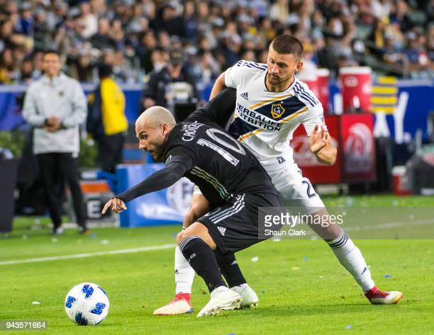 Perry Kitchen of Los Angeles Galaxy battles Yohan Croizet of Sporting Kansas City during the Los Angeles Galaxy's MLS match against Sporting Kansas...