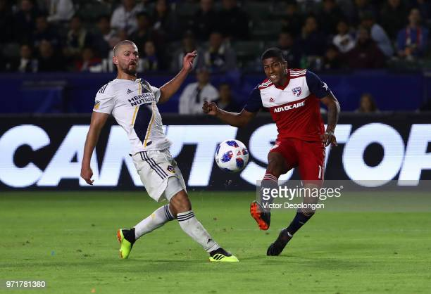 Perry Kitchen of Los Angeles Galaxy can't defend a shot by Jesse Gonzalez of FC Dallas in the second half during the MLS match at StubHub Center on...