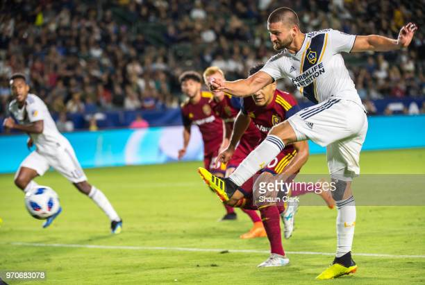 Perry Kitchen of Los Angeles Galaxy takes a shot during the Los Angeles Galaxy's MLS match against FC Dallas at the StubHub Center on June 9 2018 in...