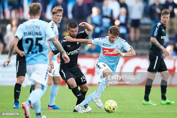Perry Kitchen of Randers FC and Philip Zinckernagel of SonderjyskE compete for the ball during the Danish Alka Superliga match between SonderjyskE...