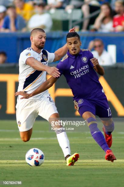Perry Kitchen of the Los Angeles Galaxy and Mohamed ElMunir of Orlando City SC fight for control of the ball at StubHub Center on July 29 2018 in...