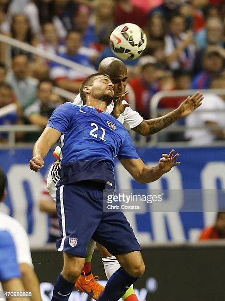 Perry Kitchen of the United States jumps for a header against Luis Rodriguez of Mexico during an international friendly match at the Alamodome on...
