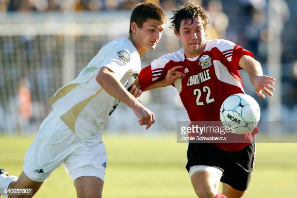 Perry Kitchen of the University of Akron and Dylan Mares of the University of Louisville battle for the ball during the Division I Men's Soccer...