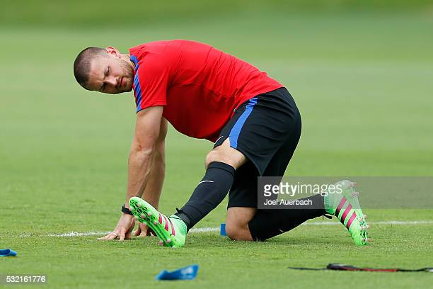 Perry Kitchen of the US Men's National team stretches during a training session on May 18 2016 at Buccaneer Field on the campus of Barry University...