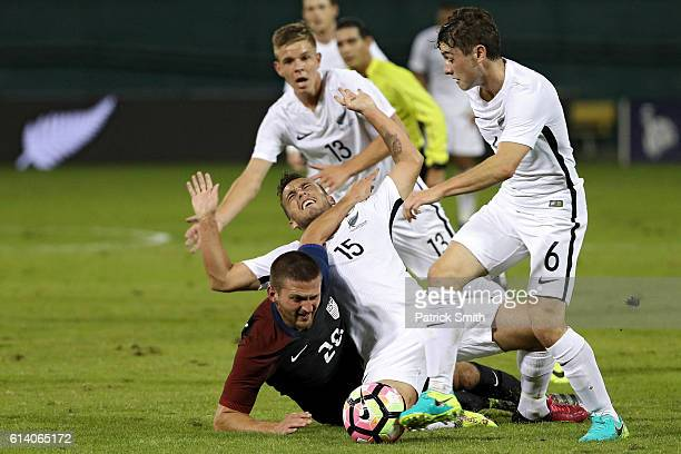 Perry Kitchen of United States and Clayton Lewis of New Zealand battle for the ball in the first half during an International Friendly at RFK Stadium...