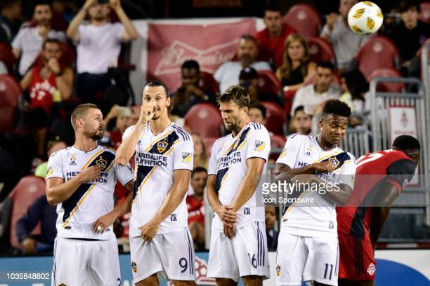 Perry Kitchen Zlatan Ibrahimovic Jorgen Skjelvik and Ola Kamara of LA Galaxy form a wall for a free kick during the first half of the MLS regular...