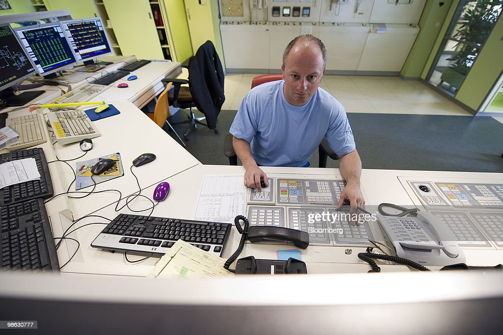 Perry Logothetis, a Solvay SA employee, monitors computer screens in the control room of the company's chemical plant in Antwerp, Belgium, on Thursday, April 22, 2010. Confidence within Europe�s chemical industry has risen for the first time in 21 months, ICIS news reported, citing data from the European Chemical Industry Council. Photographer: Jock Fistick/Bloomberg via Getty Images