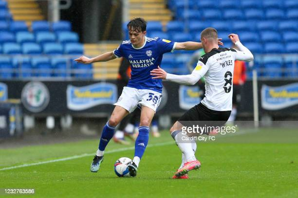 Perry NG of Cardiff City FC and Ben Wiles of Rotherham United during the Sky Bet Championship match between Cardiff City and Rotherham United at...