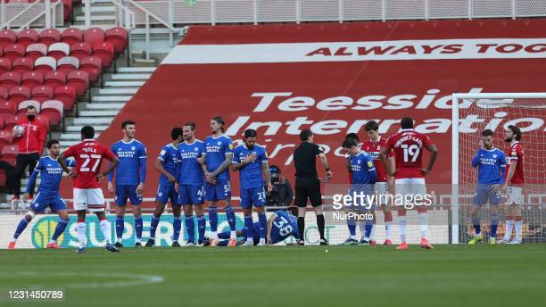Perry Ng of Cardiff City lays down behind a defensive wall as Middlesbrough prepare to take a freekick during the Sky Bet Championship match between...