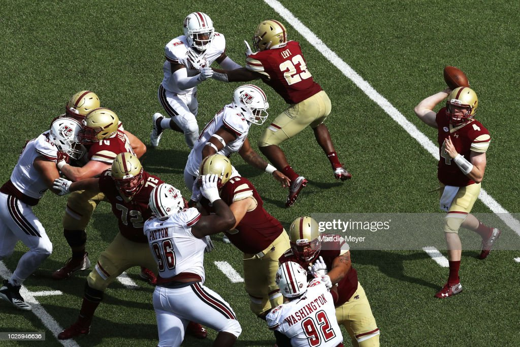 EJ Perry #4 of the Boston College Eagles makes a pass against the Massachusetts Minutemen at Alumni Stadium on September 1, 2018 in Chestnut Hill, Massachusetts.