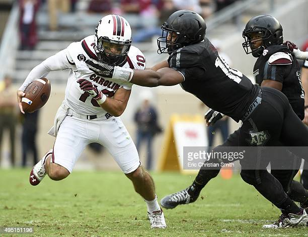 Perry Orth of the South Carolina Gamecocks is tackled by Daeshon Hall of the Texas AM Aggies in the fourth quarter of a NCAA football game at Kyle...