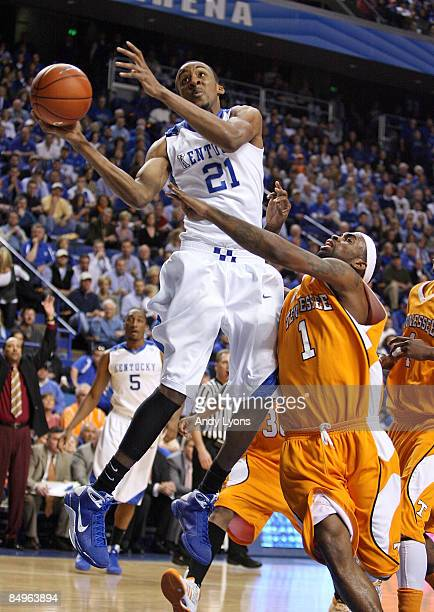 Perry Stevenson of the Kentucky Wildcats shoots the ball while defended by Tyler Smith of the Tennessee Volunteer during the SEC game at Rupp Arena...