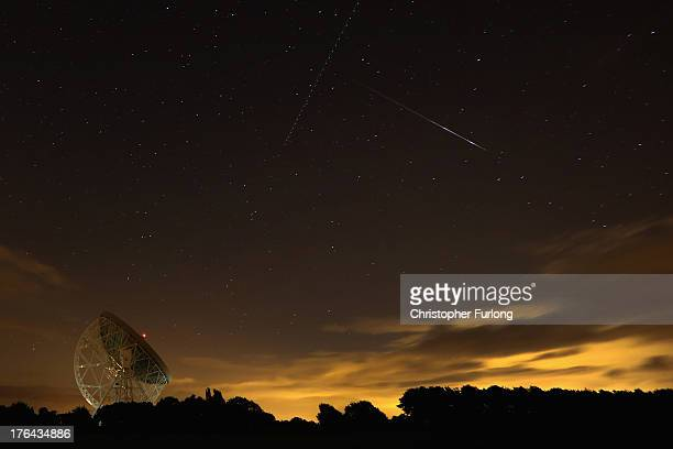 Perseid meteor streaks across the sky over the Lovell Radio Telescope at Jodrell Bank on August 13 2013 in Holmes Chapel United KingdomThe annual...