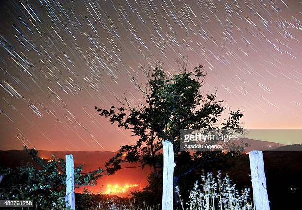 Perseid meteors streak across the sky over Inegol district of Bursa Turkey on August 12 2015 The display known as the Perseid shower because the...