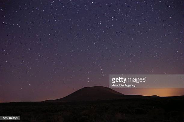 Perseid meteors streak across the sky over Meke Crater Lake in Karapinar district of Konya Turkey on August 13 2016