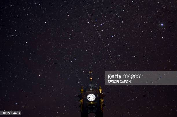 TOPSHOT Perseids meteors cross the night sky over a Catholic church in the village of Vowchyn some 380 km southwest of Minsk on August 12 2018