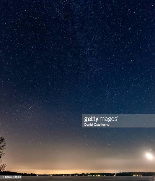 perseids shooting star over starnberg lake, germany - himmel stock-fotos und bilder