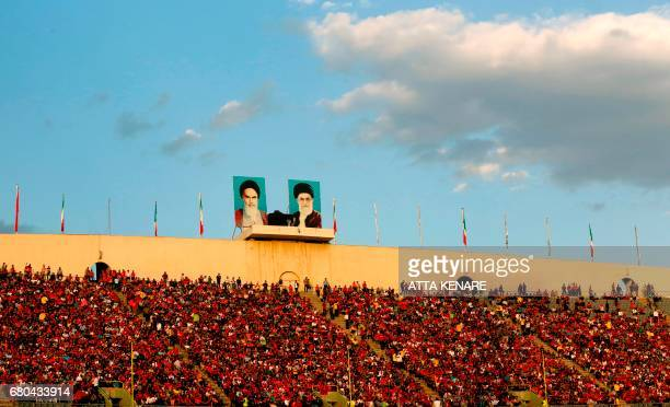 Persepolis fans cheer during the Asian Champions League football match between UAE's AlWahda and Iran's Persepolis at the Azadi Stadium in Tehran on...