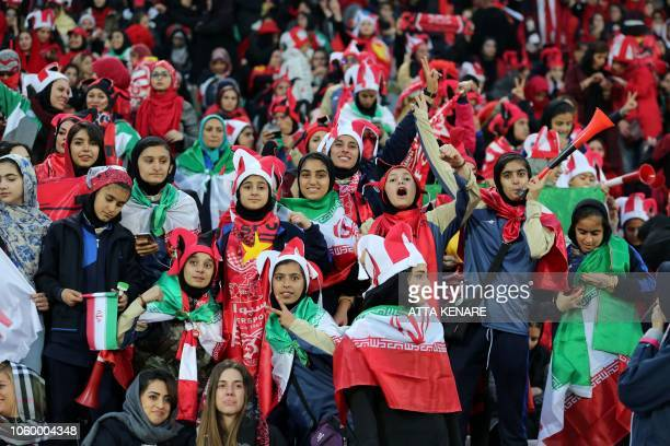 Persepolis' female fans cheer for their team during the second leg of the AFC Champions League final football match between Iran's Persepolis and...