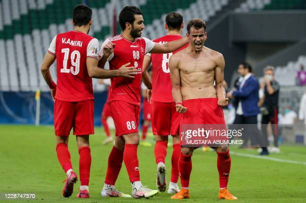 Persepolis' forward Issa Alekasir celebrates his goal during the AFC Champions League Round of 16 match between Iran's Persepolis and Qatar's Al-Sadd...