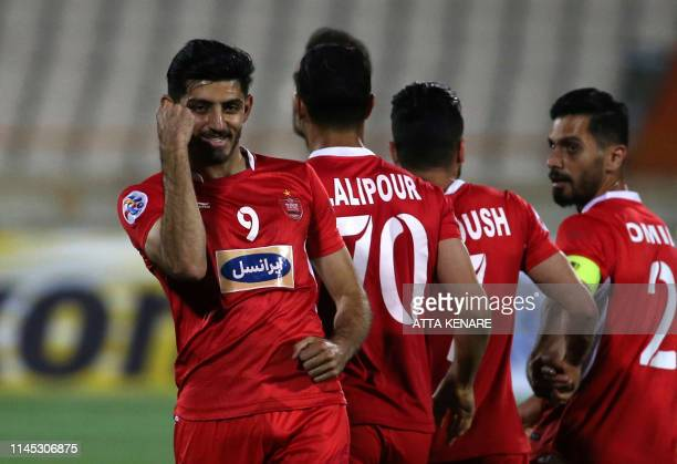 Persepolis' foward Mehdi Torabi celebrates his goal during the AFC Champions League group D football match between Iran's Persepolis and Qatar's Al...