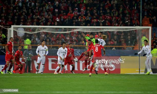 Persepolis' goalkeeper Alireza Beiranvand boxes the ball during the second leg of the AFC Champions League final football match between Iran's...