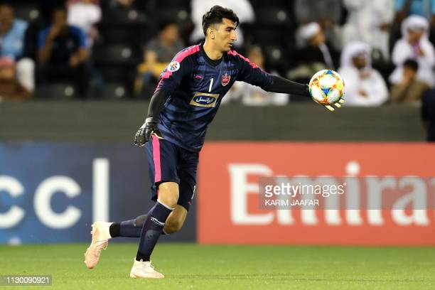 Persepolis' goalkeeper Alireza Beiranvand kicks the ball during the AFC champions league Group D football match between Qatar's Al Sadd and Iran's...