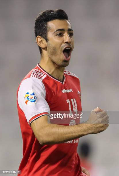 Persepolis midfielder Ehsan Pahlavan celebrates after scoring during the AFC Champions League group C match between Iran's Persepolis and UAE's...