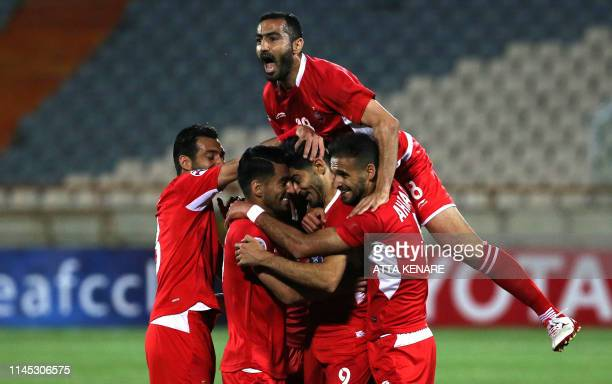 Persepolis' players celebrate their goal during the AFC Champions League group D football match between Iran's Persepolis and Qatar's Al Sadd at the...