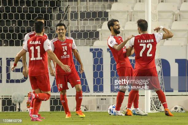Persepolis' players celebrate their second goal during the AFC Champions League quarter-finals match between Iran's Persepolis and Uzbekistan's...