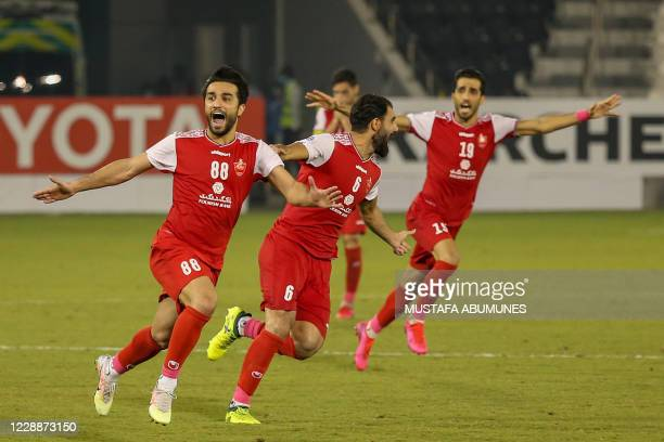 Persepolis' players celebrate their win during the AFC Champions League semi-finals match between Saudi's Al-Nassr and Iran's Persepolis on October 3...
