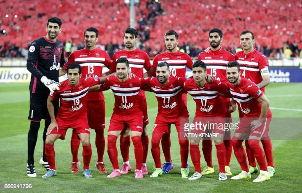 Persepolis' players pose for a group picture ahead of the Asian Champions League football match between Qatar's AlRayyan and Iran's Persepolis at...
