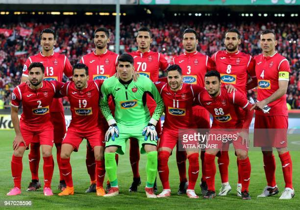 Persepolis' starting eleven pose for a team photo ahead of the AFC Champions League match between alSadd and Persepolis at the Azadi Stadium in...