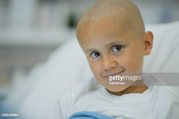 perseverance - bald girl stock photos and pictures