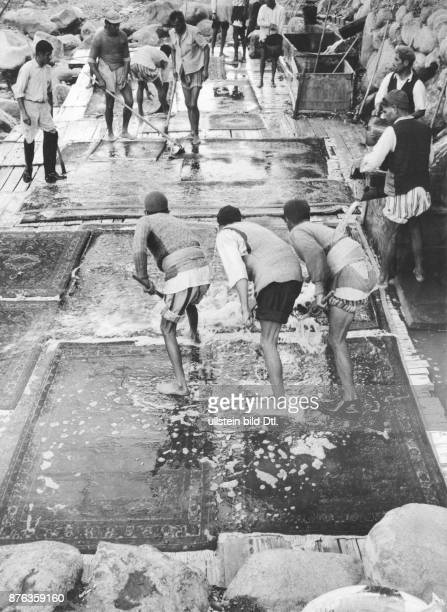 Persia / Iran carpet laundry in Hamadan men washing carpets for the export to Europe FC Gundlach